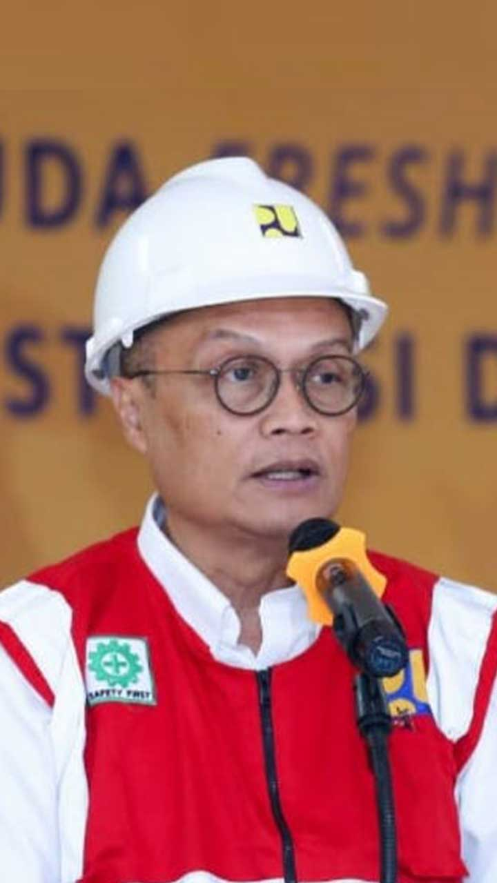 Jhon Wempi Wetipo, SH, MH